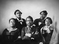 Kamehameha III with Queen Kamala to the left and Victoria Kamāmalu (original owner of the first palace) to the right with future monarchs Kamehameha IV, top left and Kamehameha V, top right