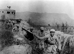 Victorious Chinese Communist soldiers holding the flag of the Republic of China during the Hundred Regiments Offensive