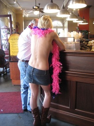 A topless woman at a coffee house, Mardi Gras event in New Orleans, 2009