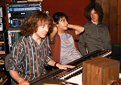 Mitch Easter sitting at a mixing board next to Michael Quercio and Scott Miller