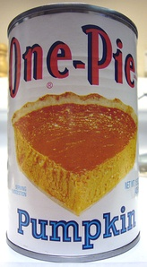 A can of pureed pumpkin, typically used as the main ingredient in the pie filling