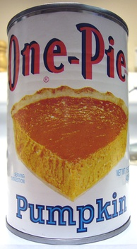 A can of puréed pumpkin, typically used as the main ingredient in pumpkin pie