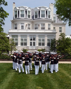 The Silent Drill Platoon performs in front of the home of the Commandant of the Marine Corps