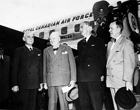 Prime Minister Louis St. Laurent (far left) and Pearson (far right) welcome UK Prime Minister Sir Winston Churchill and Foreign Secretary Sir Anthony Eden at Rockcliffe Airport, Ottawa, on 29 June 1954.