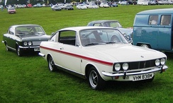 Two 1973 Sunbeam Rapiers: first with side windows lowered and raised on the second car