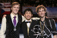 Rippon (right) at the 2009 Trophée Éric Bompard podium