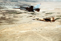 A Jordanian Mirage F1EJ in formation with an American F-16 Fighting Falcon over Iraq, 1996