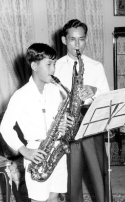 The late king Bhumibol Adulyadej and his son king Vajiralongkorn playing saxophone