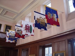 Banners bearing heraldic badges of several officers of arms at the College of Arms in London