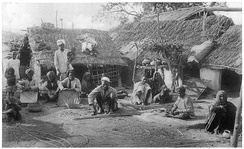 The Basor weaving bamboo baskets in a 1916 book. The Basor are a Scheduled Caste found in the state of Uttar Pradesh in India.