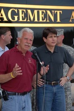 Quincy mayor John Spring appears at a press conference with Blagojevich to discuss Mississippi River flood-relief efforts in 2008.