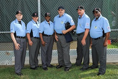 Little League umpires wearing blue