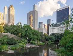 View of The Pond and Midtown Manhattan from the Gapstow Bridge in Central Park, one of the world's most visited tourist attractions, in 2019.