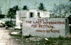 """COOLEY GO HOME""A mural was painted near the festival's office by festival protesters."