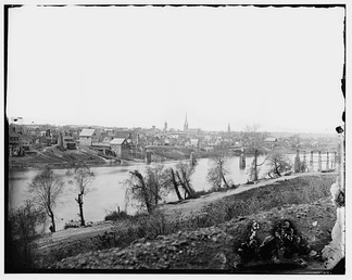 Fredericksburg, Virginia, March 1863. View from across the Rappahannock River. To the right is the steeple of Fredericksburg Baptist Church, and toward the center is the tower of St. George's Church. To the left of center are two mill buildings of the manufacturing district.