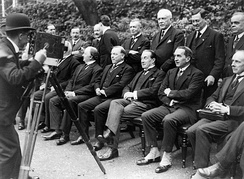 Prime Minister Stanley Baldwin (seated centre with his legs crossed) poses in the garden of Number Ten with representatives to the 1923 Imperial Conference.