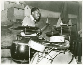 "Drummer in a Memphis ""juke joint"" orchestra playing a kit with four non-tunable toms. Marion Post Wolcott, October 1939"