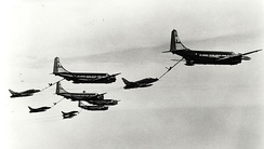 "108th Air Refueling Squadron KC-97 Stratotankers performing aerial refueling of F-100 Super Sabres during Operation ""Ready Go"", the first all United States Air National Guard (ANG) non-stop deployment of fighter aircraft to Europe, 1964"