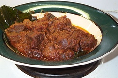 Rendang daging, a beef, mutton or goat meat dish, that has been marinated with various different spices for several hours, and slow-cooked with coconut milk.