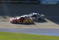 Larson and Chase Elliott battle for the lead in the later stages of the 2017 FireKeepers Casino 400, his third career victory.