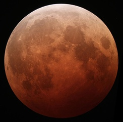 The Moon, tinted reddish, during a lunar eclipse
