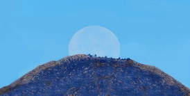A full Moon sets behind San Gorgonio Mountain (in California) on a midsummer's morning.