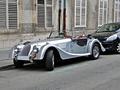 "The Morgan +4 and 4/4 are classic ""front mid-engine, rear-wheel-drive layouts""."