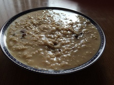 Oatmeal cooked with water to create a runny bowl of porridge
