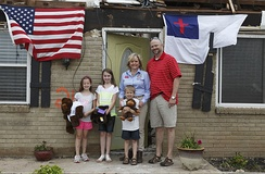 Governor Mary Fallin stands with a family that survived the devastating 2013 Moore tornado with winds exceeding 200 miles per hour