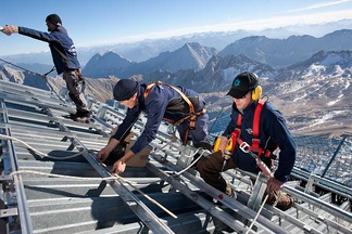 Workers constructing a photovoltaic system.