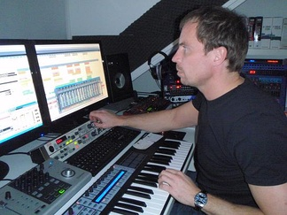 Music production using a digital audio workstation (DAW) with multi-monitor set-up