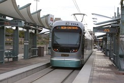 photo of streamlined light rail car pulling into a station