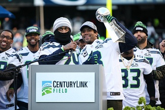Russell Wilson and Marshawn Lynch with the Vince Lombardi Trophy at the CenturyLink Field in Seattle, February 5, 2014