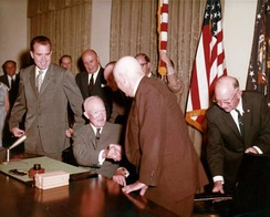 Rayburn and President Eisenhower shaking hands at the signing ceremony for the Alaska Statehood Act
