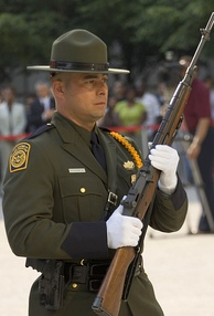 A Border Patrol Honor Guard Agent carrying an M14 rifle.