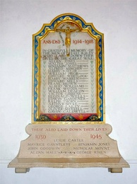 War memorial in East Ilsley, restored in 2008, and featuring combined original list of World War I and later World War II names[332]