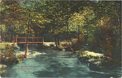 "The ""Kissing Bridge,"" which no longer exists, crossed the Freeport-Baldwin border over Milburn Creek at Seaman Avenue. Postcard c. 1913."