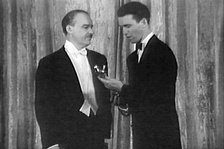 Alfred Lunt presents James Stewart (right) with the Best Actor award for The Philadelphia Story.