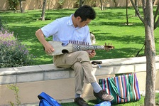 A man playing the rubab in a park in Kabul