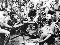 Filipino aviation cadets being trained by a U.S. Marine on use of a M1917 Browning machine gun in the Philippine Islands