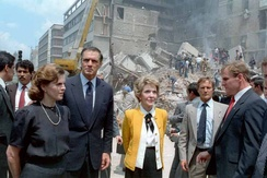 First ladies Paloma Cordero of Mexico (left) and Nancy Reagan of the United States (right) with U.S. Ambassador to Mexico, John Gavin observing the damage done by the earthquake.