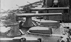 12-pounder guns mounted on 'X' turret; note the sighting hoods on the turret roof.
