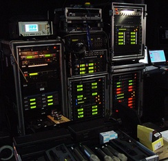 Wireless microphone receiver racks backstage at a large televised music awards event