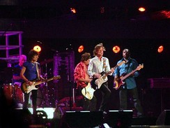 "The Oxford Dictionary of Music states that the term ""pop"" refers to music performed by such artists as the Rolling Stones (pictured here in a 2006 performance)"