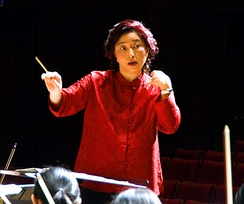 Apo Hsu, using a baton, conducts the NTNU Symphony Orchestra in Taipei, Taiwan