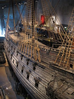 The early-17th-century galleon Vasa. on display at the Vasa Museum in Stockholm. Vasa, with its high stern castle and double battery decks, was a transitional design between the preferences for boarding tactics and the line of battle.