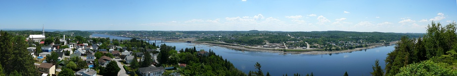 Panoramic view of the Saguenay River from St Anne's Cross (north shore) with downtown Chicoutimi in the background.