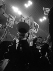 Convention-goers at the 1956 Republican National Convention holding signs for Richard Nixon.