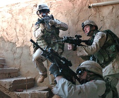 Soldiers from 1st Infantry Division clearing a building in Fallujah, 19 November 2004.