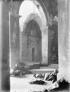 Wounded of the 5th Battalion Somerset Light Infantry and 4th Battalion Wiltshire Regiment in a Dressing Station located in the monastery at Kuryet el Enab which the 75th Division captured on 20 November 1917